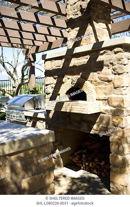 Outdoor stone oven near bbq grill