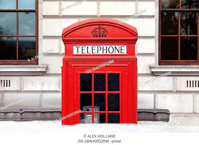 Red telephone box on city street