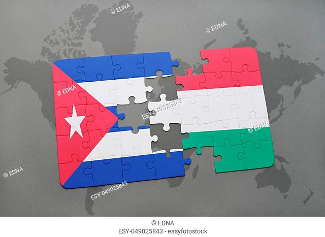 puzzle with the national flag of cuba and hungary on a world map background. 3D illustration
