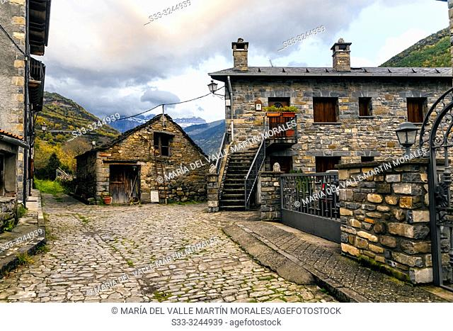 Typical houses in Broto and Pyrenees on the background.. Huesca. Aragon. Spain. Europe