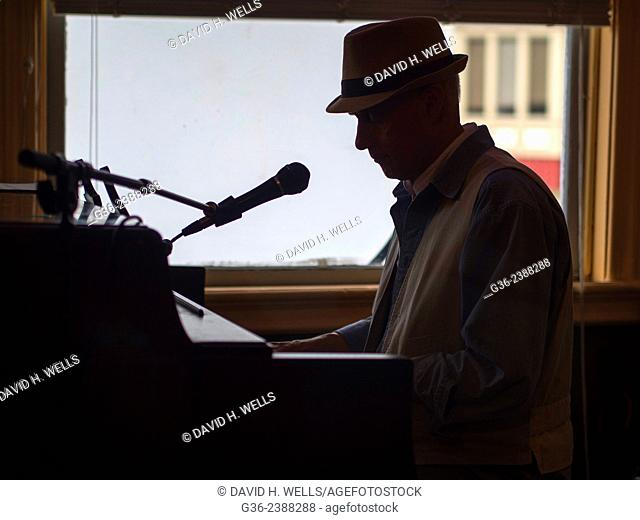 Silhouette of man playing piano in Providence, Rhode Island, United States