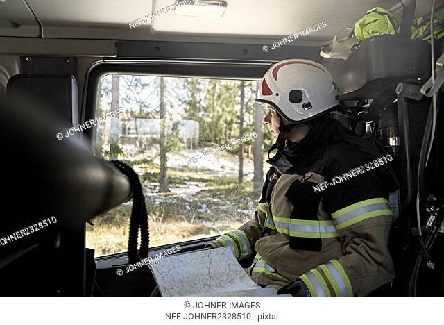 Firefighter in car