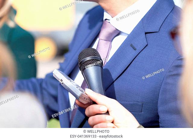 Press or media interview with business person or politician