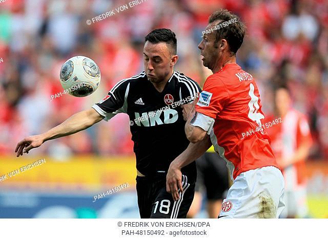 Mainz' Nikolce Noveski (R) and Nuremberg's Josip Drmic (L) vie for the ball during the German soccer Bundesliga match between 1. FSV Mainz 05 and 1