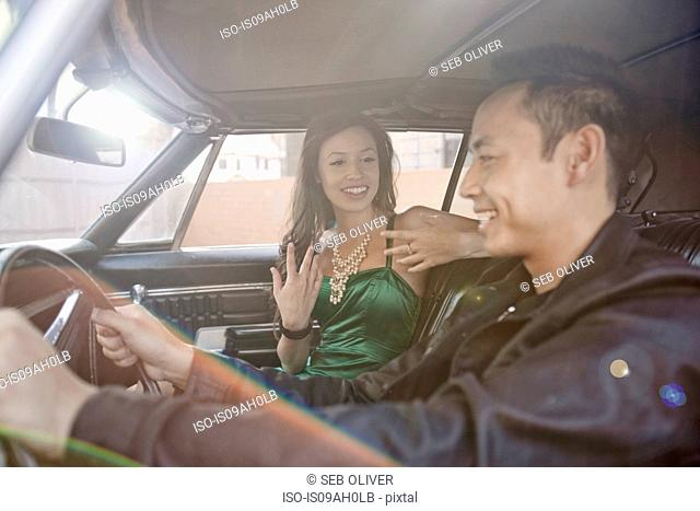 Happy couple chatting whilst driving in car