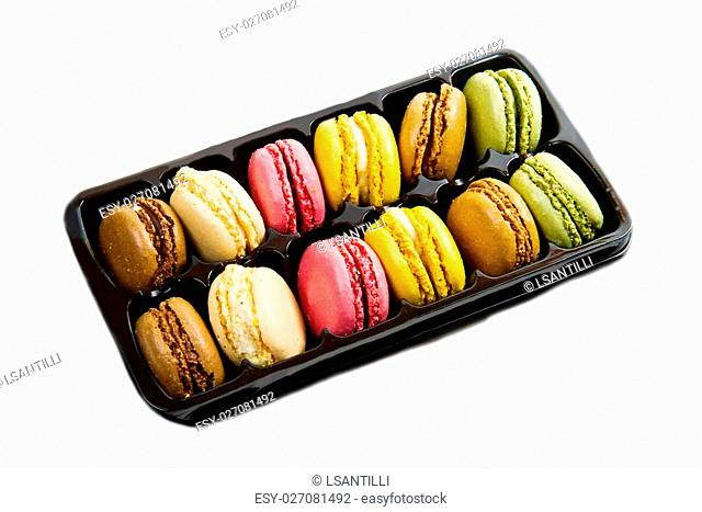 colored macarrons in black box