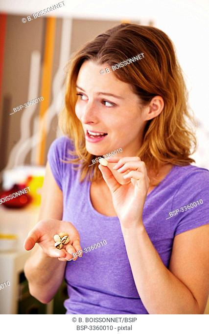 WOMAN EATING DRIED FRUIT Model