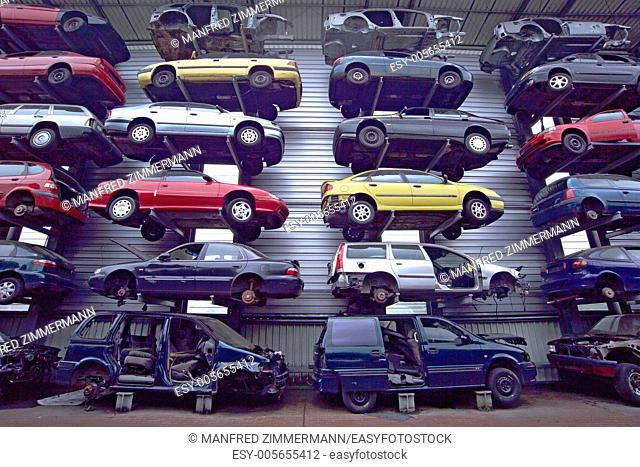 Disused cars on junkyard, stacked.Autofriedhof neatly in Germany