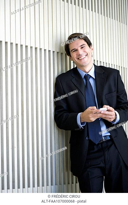 Businessman relaxing with smartphone
