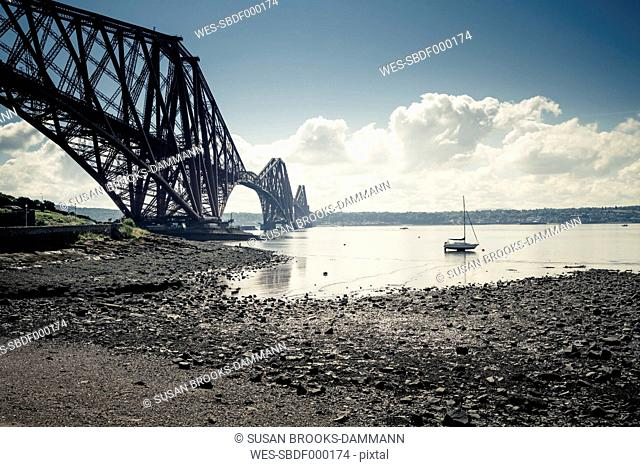 Great Britain, Scotland, Forth Bridge South, low tide and sailboat