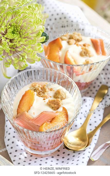 Pickled rhubarb and peaches with crumble and vanilla cream