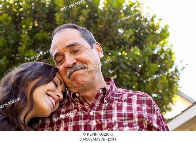 Father and daughter sharing tender moment