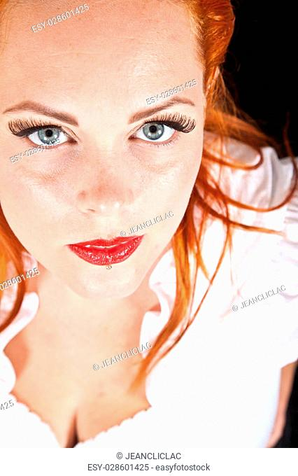 Red hair girl in pin-up style portrait