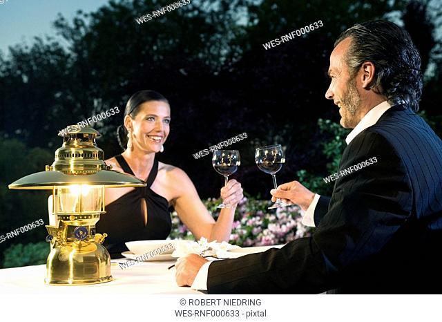 Germany, Bavaria, Couple having candlelight dinner