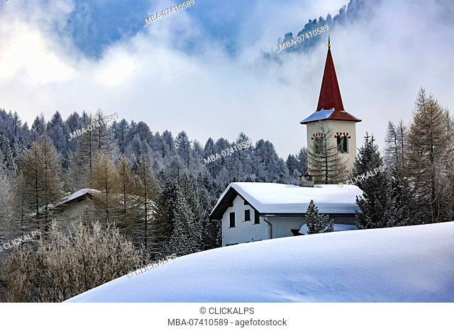 Church Chiesa Bianca in winter, Maloja, Engadin, Canton Grisons, Switzerland, Europe