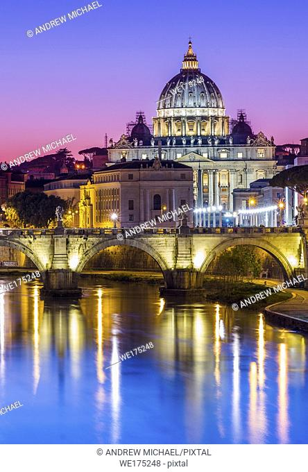 St Peter's Cathedral and Vatican city seen at dusk, over the river Tiber. Rome, Lazio, Italy