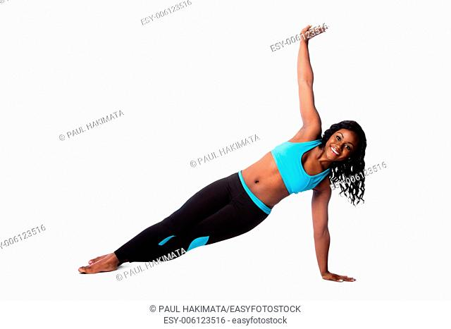 Beautiful woman doing floor pilates yoga workout fitness exercise for health, bodycare concept, t-stand pose