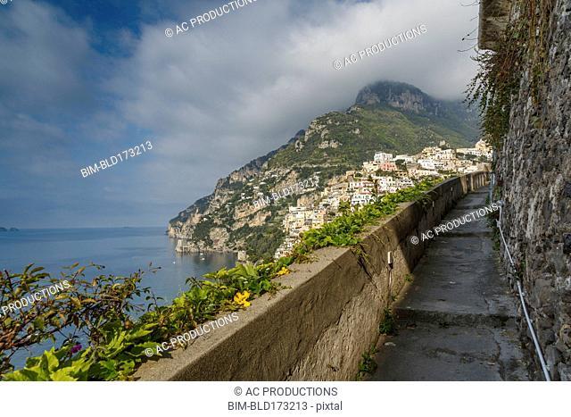 Rocky balcony overlooking Positano cityscape, Amalfi Peninsula, Italy