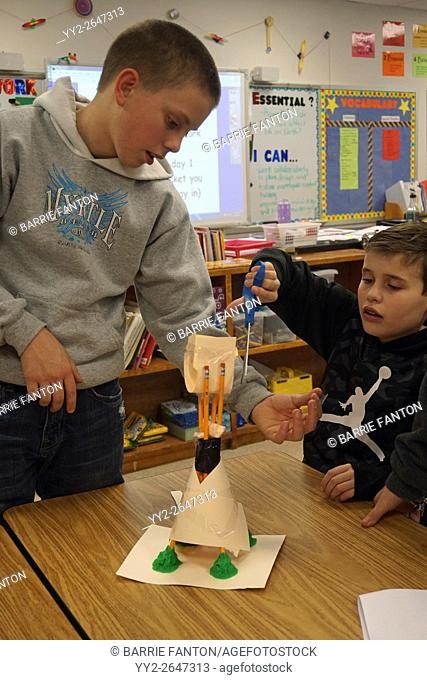 Middle School Boys Working on Science Experiment, Wellsville, New York, USA