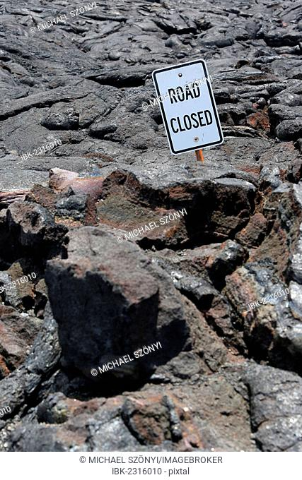 Road closed, a sign on a lava field in the eastern rift zone, Kilauea volcano, Big Island, Hawaii, USA