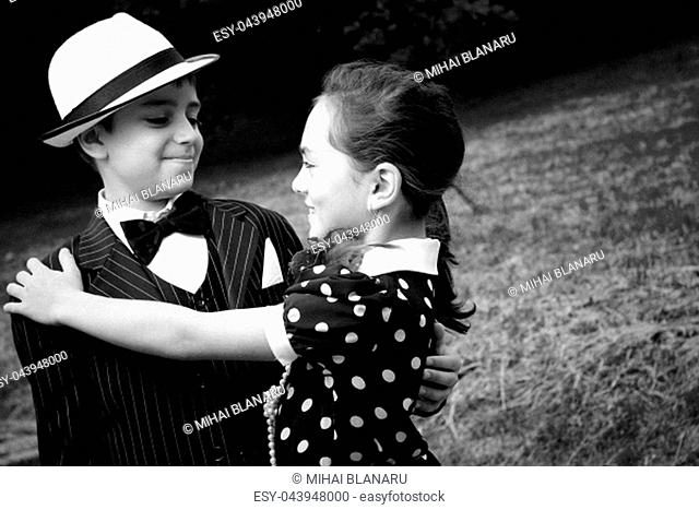 Portrait of a very young couple in retro garment. More images with the same models