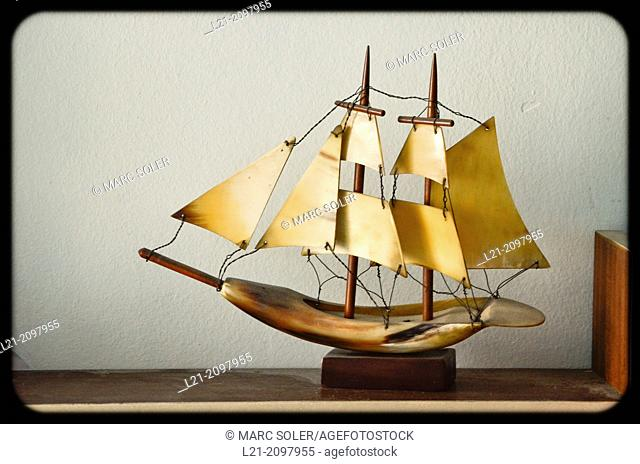 Miniature sailboat on a shelf