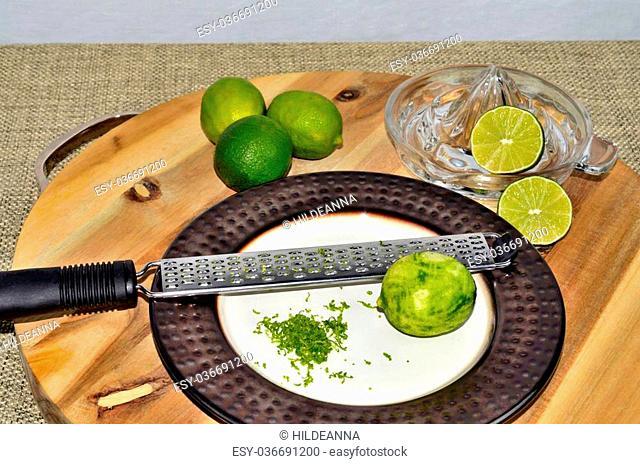 Citrus fruit, zest with zester and juicer