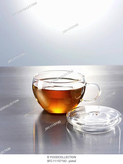 Black tea in a glass teacup