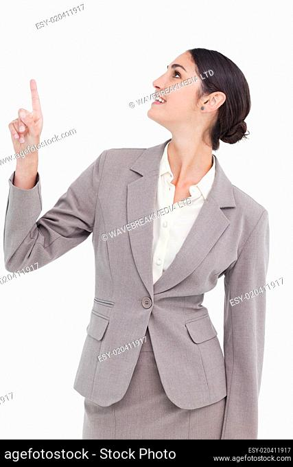 Smiling businesswoman looking and pointing up