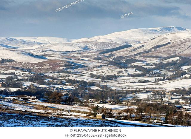 View of snow covered farmland and hills, from above Burtersett, looking towards Hawes, Upper Wensleydale, North Yorkshire, England, December