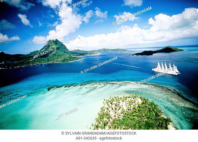 Aerial of Bora-Bora lagoon in the Leeward islands. Society archipelago. French Polynesia