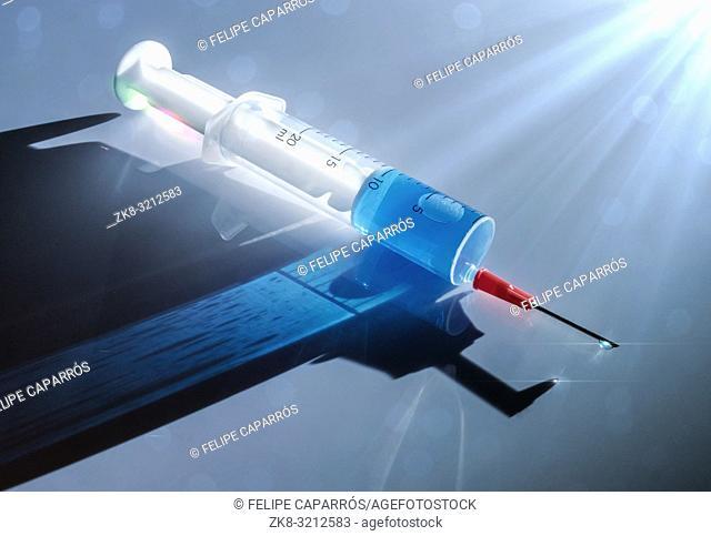 Syringe with medication illuminated laterally, conceptual image