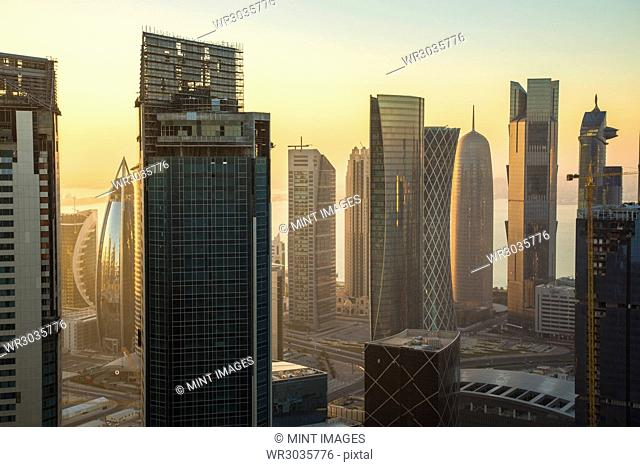 Cityscape with tall modern skyscrapers at dusk