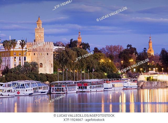 Gold tower in Guadalquivir river  In the background towers of España square  Seville, Andalusia, Spain