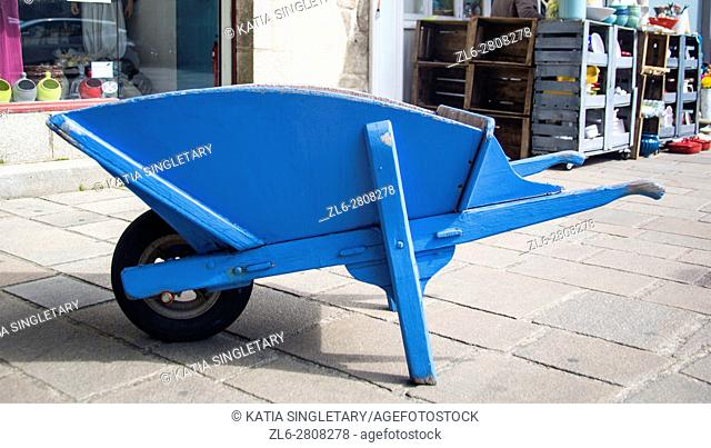 Blue old fashion wood Wheel barrow to carry the salt in France from salt march