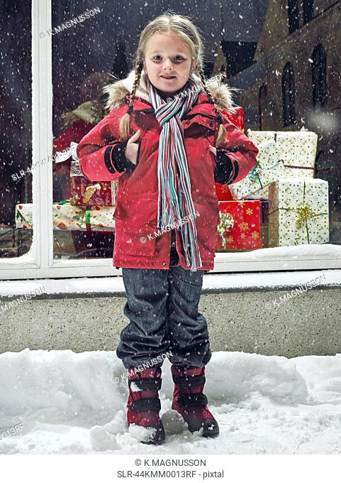 Smiling girl standing in snow