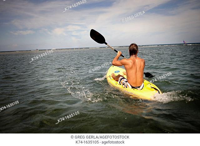 Man Kayaking in Ocean