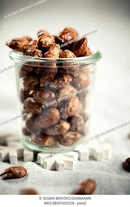 Candied almonds in jar, studio shot