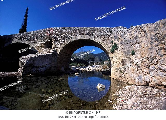 An old stone bridge in Pollenca in osten of the island Majorca in the Mediterranean Sea in Spain