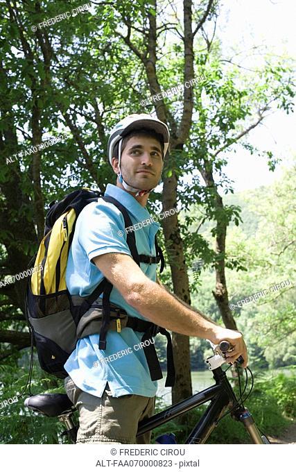 Man bike riding in woods