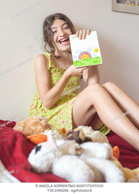 Pre-teen Girl Showing her Draw and smiling