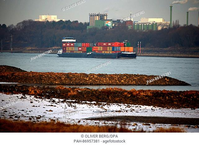 A container ship sailing on the Rhine river in Cologne, Germany, 03 January 2017. On the Rhine, boats are currently not fully loaded due to the low water level