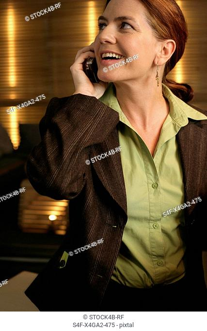 Woman phoning with a mobile phone