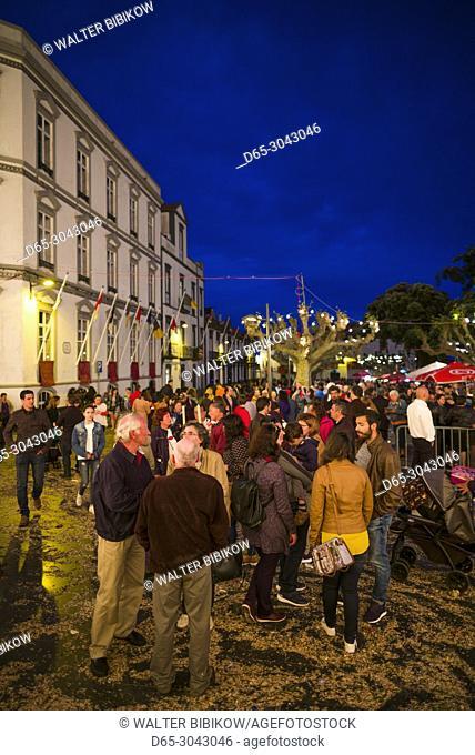 Portugal, Azores, Sao Miguel Island, Ponta Delgada, Festa Santo Christo dos Milagres festival, Praca 5 Outubro square, people at the festival, evening