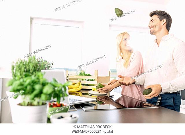 Couple preparing breakfast in the kitchen
