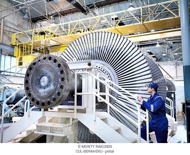 Engineer in steam turbine repair workshop