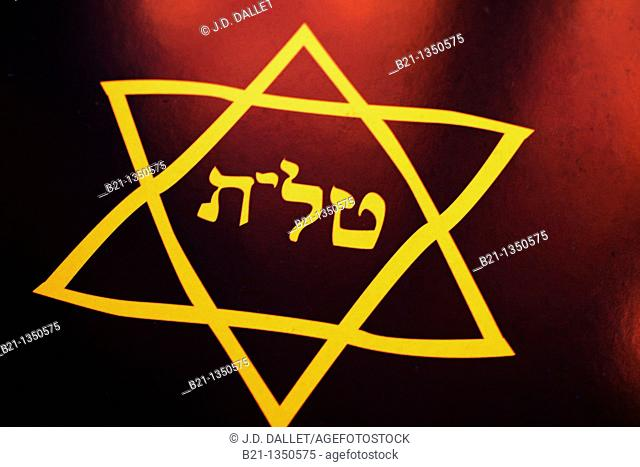 Religion- Jewish- A tallit Hebrew:  talet1 in Sephardic Hebrew and Ladino tallis,2 in Ashkenazic Hebrew and Yiddish pl  tallitot talleisim,3 tallism