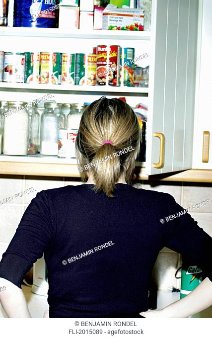 Woman Looking In The Cupboard