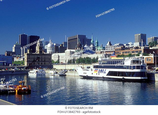 Montreal, Canada, Quebec, Vieux Port along the St. Lawrence River (Fleuve Saint-Laurent). Skyline of downtown Montreal