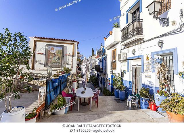 Colored picturesque houses, street. Typical neighborhood historic center, casco antiguo,barrio santa cruz. Alicante, Spain